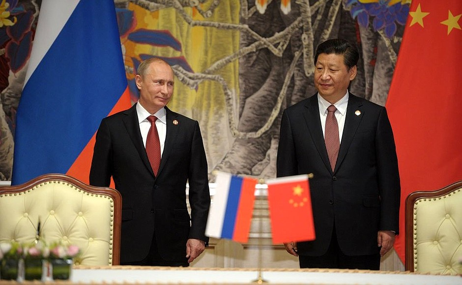 "Chinese President Xi Jinping and Russian President Vladimir Putin sign an energy ""mega-deal"" in 2014. Credit: Kremlin."