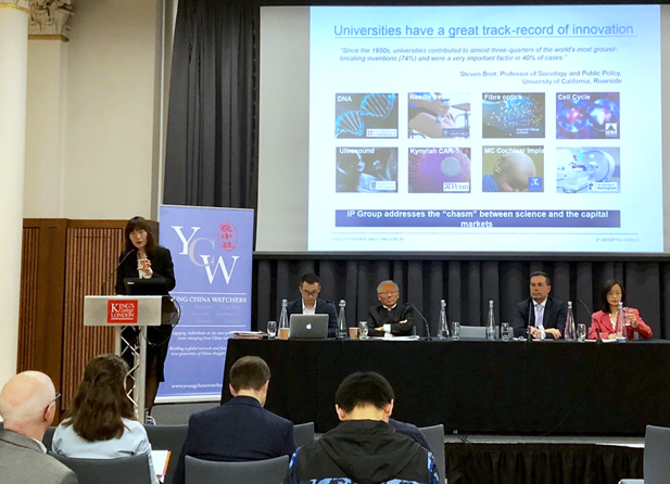 Joyce Xie (far left) speaks during Panel 3. (Seated left to right: Bin (William) Xu, George Yip, Syrus Lohrasb, Ting Zhang)