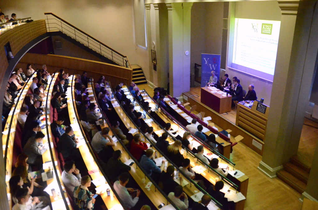Attendees listen to the first panel discussion of the conference